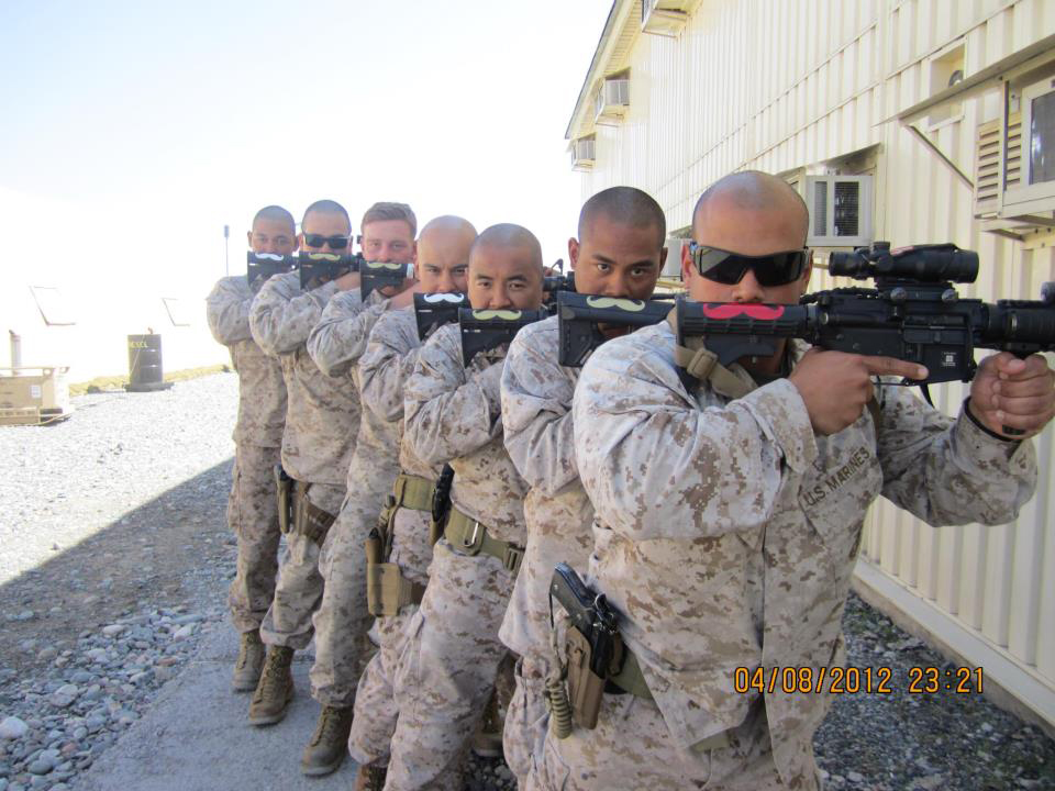 Marine's with mustaches on guns